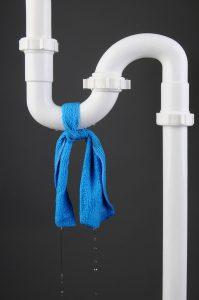 blue cloth tied around white pipe