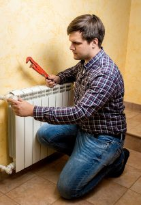 heating technician working on heating system