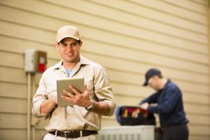 HVAC-technicians-working-on-system
