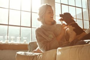 woman-with-dog-enjoying-being-indoors