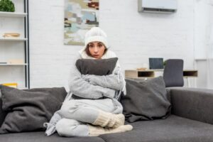woman-in-warm-clothes-hugging-pillow