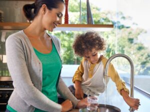woman-and-child-getting-water-from-kitchen-sink